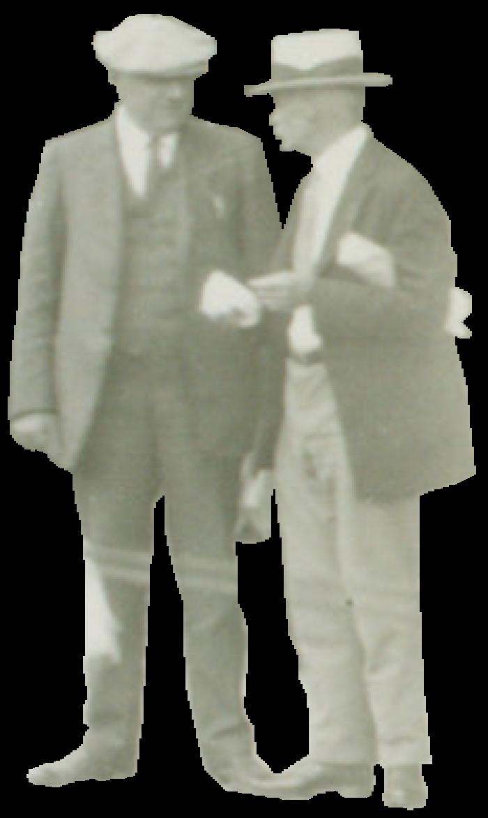 Two men standing in suits