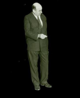 Man in suit holding paper