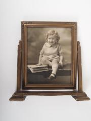 Photograph, Of a Seated Child with an Opened Book