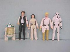 Five Star Wars Action Figures,  R2 D2, Hans Solo, Princess Leia Organa, Luke Skywalker, Imperial Storm Trooper
