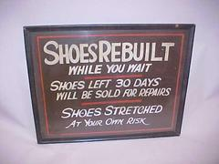 Sign, Shoes Rebuilt While You Wait.  Shoes Left 30 Day Will Be  Sold For Repairs. Shoes Stretched. At Your Own Risk