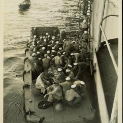 Photograph, Sailors boarding a landing craft(PA4 3-7) in the Pacific