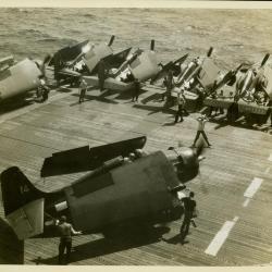 Photograph, U.S. Navy Hellcat planes on the flight deck of the U.S.S. Rudyerd Bay.
