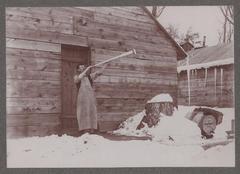 Photograph, Cook Blows Dinner Horn at Lumber Camp