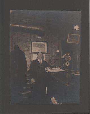 Photograph, Man Standing at Desk