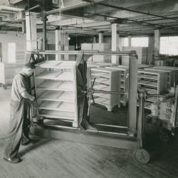 Photograph, Kindel Furniture Co., Furniture Worker Applies Glue to Dresser
