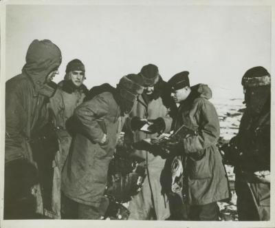 Photograph, Major Hauenstein inspecting code book, Iceland