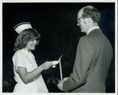 Photograph, Pine Rest Nurse lighting a Candle