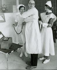 Photograph, Pine Rest Nurses with Straightjacket