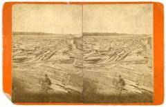 Stereoview, Two Men Resting on the River Shore of a Log Jam